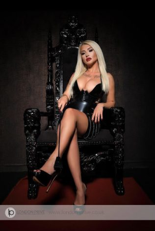 Busty Blonde Mistress Eve: Mistress Eve is one of the best fetish escorts. This hot blonde is true party girl always up for a great time.