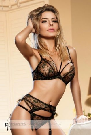 Naughty Italian Blonde Evelyn: This exotic Italian blonde is something extraordinary, not just because of her extraordinary open-minded and naughty personality...